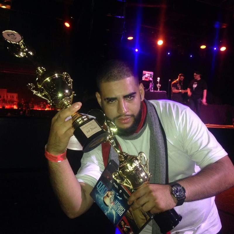Juan Sosa showing trophies at HairBattleTour - San Francisco 2014