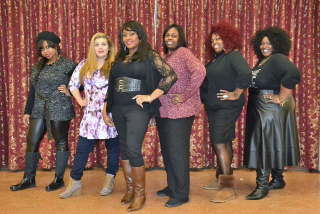 Empowering Through Beauty Founder/CEO Tanisha Akinloye poses with some of the professional hairstylists and makeup artists volunteers.